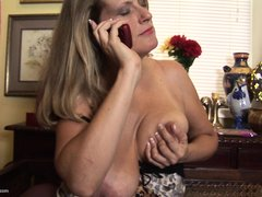 Daphne, a hot 44 years old milf is talking on the phone and she decides to masturbate. She can't wai