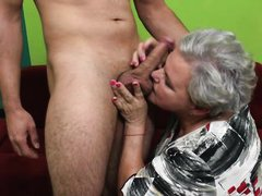 old granny gives him a blowjob and tickles his balls