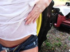 Cute babe Julie Cash has been told to go out and wash the new John Deere by her father. She goes out