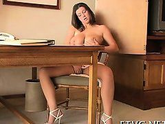 Attractive girl plays with sex tools