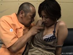 This mature Japanese housewife will do anything to please her husband. She waits on him hand and foo