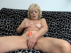 Granny needs to climax. She's horny and alone but this bitch has her dildo! She takes a sit on the c