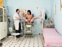 Although she's old her pussy is in good shape as her gynecologist exams with a plastic speculum. She