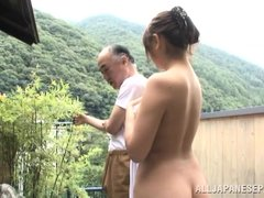 This cute Japanese girl is enjoying the great outdoors and fresh air, while relaxing in this onsen.