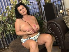 Lorie has one of the biggest pairs of saggy tits you have ever seen. She licks her nipples and juggl