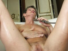 carla fingers herself alone in the tub