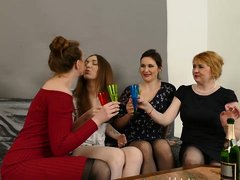 Naughty lesbians have gathered up in the living room to eat each other up during a foursome