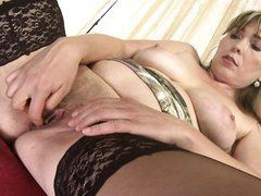 slippery mature pussy between her sensual thighs