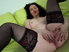 Watch this horny milf satisfying her crazy for sex by playing with a dildo. She is naked and wearing