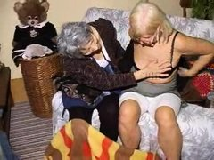 Two very old and saggy grannies and on their couch. These whores may be old but they are still lustf