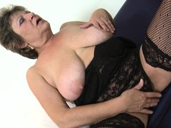 This dirty slut juggles her saggy boobs and then spreads her legs wide open to reveal her old pussy.