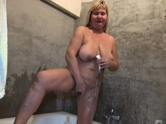 She's an old whore and boy does she looks good under the shower. Nanny Sonja is wet and she rubs her