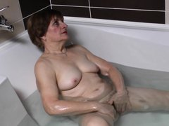 Watch this horny 70 years old lady masturbating all alone while taking a bath. She is all naked, sho