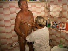 The old fart is taking a shower when his woman comes to help him wash. They may be old but they stil