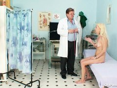this doctor is not a good person as he teases different parts of her mature body to satisfy his feti
