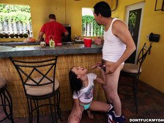 This guy has guts to get his hard cock sucked by his sexy girlfriend right in front of her dad, whil