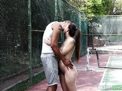 horny brunette gets naked on the field
