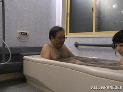 This old pervert gets in the bathtub with this cute girl and she gives him a nice wash. She washes h
