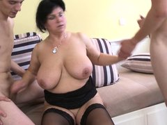 Fat mature lady Violette V has a gangbang with two young men on the couch. She gets fucked hard in t