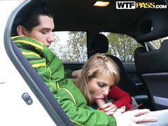 breasty blonde giving blowjob in the car