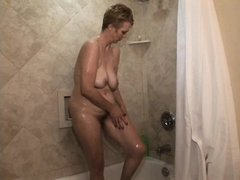 She's taking a shower and makes sure that those saggy tits and her sexy pussy are clean. Now that sh