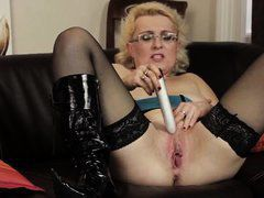 hot mom making her satisfy with a dildo.