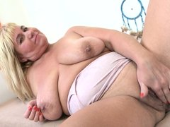 Kirsi takes off her top and shows you her very saggy tits. She lifts them up to her mouth and licks