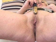 This slutty blonde lady is in her room and touching her body softly to make her feel horny. She is g