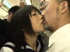 Horny little schoolgirl is in a crowded public transportation. The older man in front of her makes h