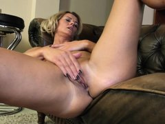 This hot milf feels kinda lonely. She is lying on her couch and starts touching her own nipples. She