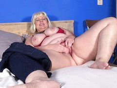 fat, mature blonde plays with a dildo
