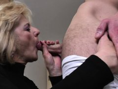 This horny mature women cannot wait to get hands on her younger partner's hot cock, and unzips his p