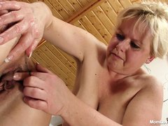 Chunky mom Klaudia plays with her girlfriend Majda and a lot of sex toys. Majda is a horny mom, just