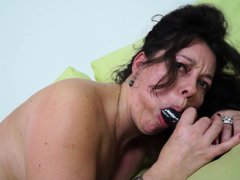 Watch this brunette mature lady with a hot body and round white ass, fucking herself all alone with