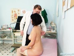 Mature lady with big tits is in doctor's clinic for her pussy to be examined. Firstly her eyes are c