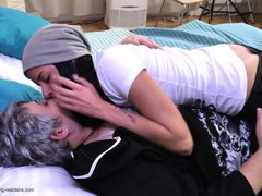 This huge mature lady in on the bed and her sexy young lover, gets into bed with her. The young slut