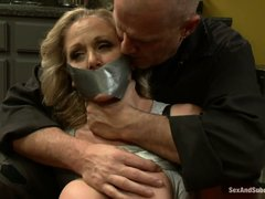 Mature blonde Julia needs to learn something about obedience. Here she is in the kitchen, cooking th