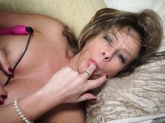Lusty blonde woman plays with her pearls, when she suddenly realizes that she could play with her pu