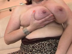 She's a mature with a lot of lust, this cunt plays with her huge saggy boobs and tries to suck her n