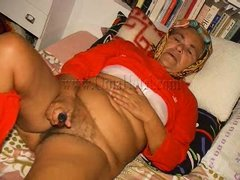 Horny grandma Heidrun is lying on the bed with her hair rollers on and thinks about something dirty.