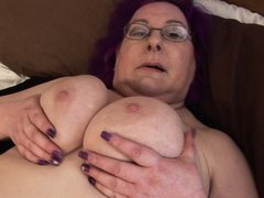 See this European granny playing with her chubby body. This horny lady spreads her legs and keeps ru