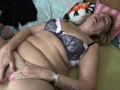 Granny Emmy keeps a hot bush between her thighs. Her tight, unshaved vagina needs a serious fuck so