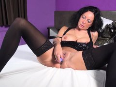 Wanna take a look at a brunette mature lady's intimacy? Go ahead and see slutty Elisa, playing with