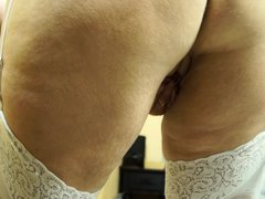 This dirty mature is looking sexy with her stockings and garters. She has a floppy pair of natural b