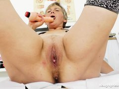 Nurse Berta is a chunky mature with a shaved pussy. She loves to play solo now and then and this tim