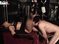 She lets him eat her out and give her an enema up her ass while she´s all tied up with her legs spre