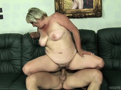 Granny was lying nude on sofa. I saw her masturbating, and felt horny. I undressed myself and insert
