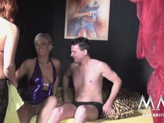 A couple of swinger ladies go down and bend over for young studs.