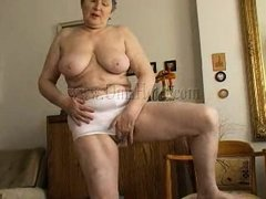 Granny takes off her shirt and bra and her heart rate increases as she begins massaging those big sa