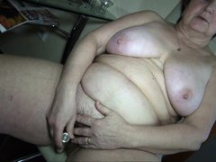 Wearing her white panties and bra, nanny Hana shows what she does in her kitchen. No, this granny is